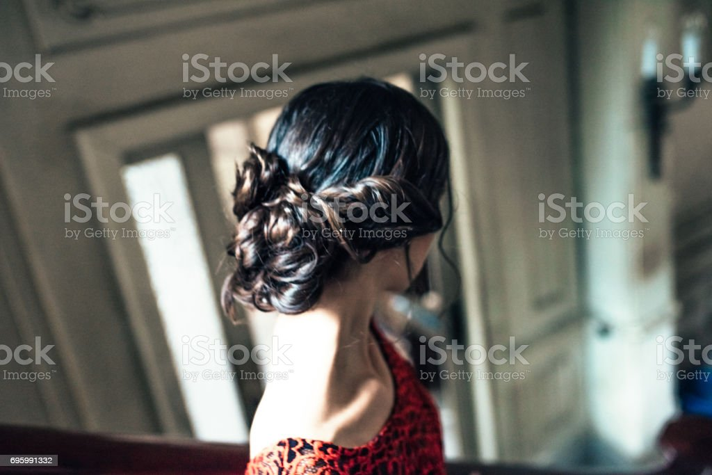 beautiful young cuban woman in red dress on stairs in old house stock photo