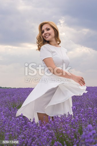 Beautiful young dancing woman portrait in lavender field