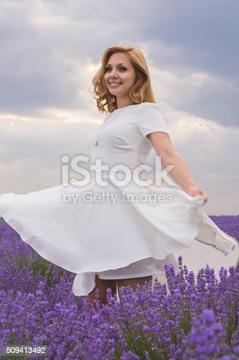 1054970060istockphoto Beautiful young dancing woman portrait in lavender field 509413492