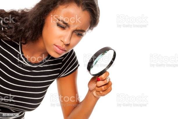 Beautiful young dark skinned woman looking trough the magnifying picture id854646748?b=1&k=6&m=854646748&s=612x612&h=8f8w89fvtjlnxjuvgrzqogxce2ypb  2ndcjtagp5 i=