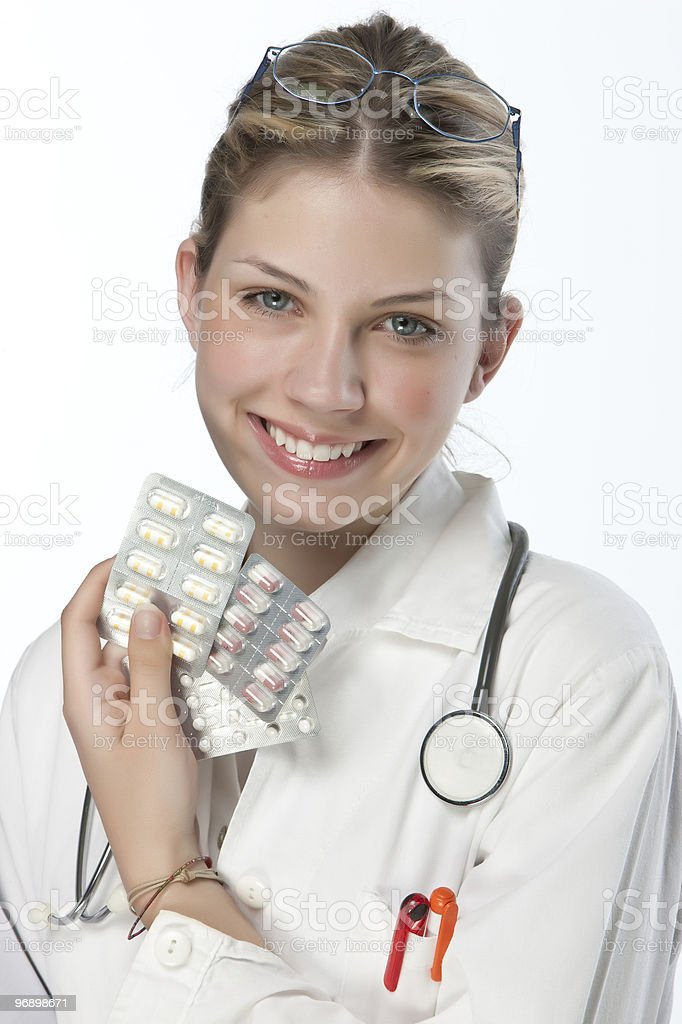 Beautiful young doctor with pills royalty-free stock photo