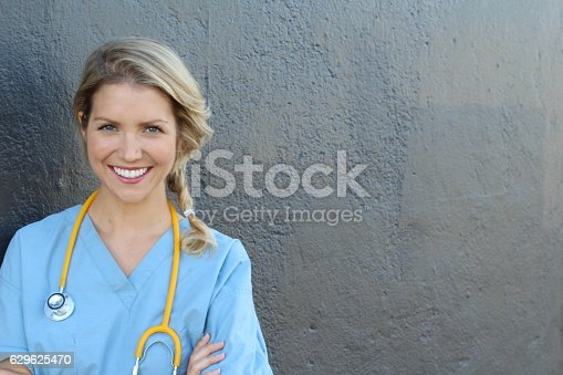 istock Beautiful young doctor with stethoscope 629625470