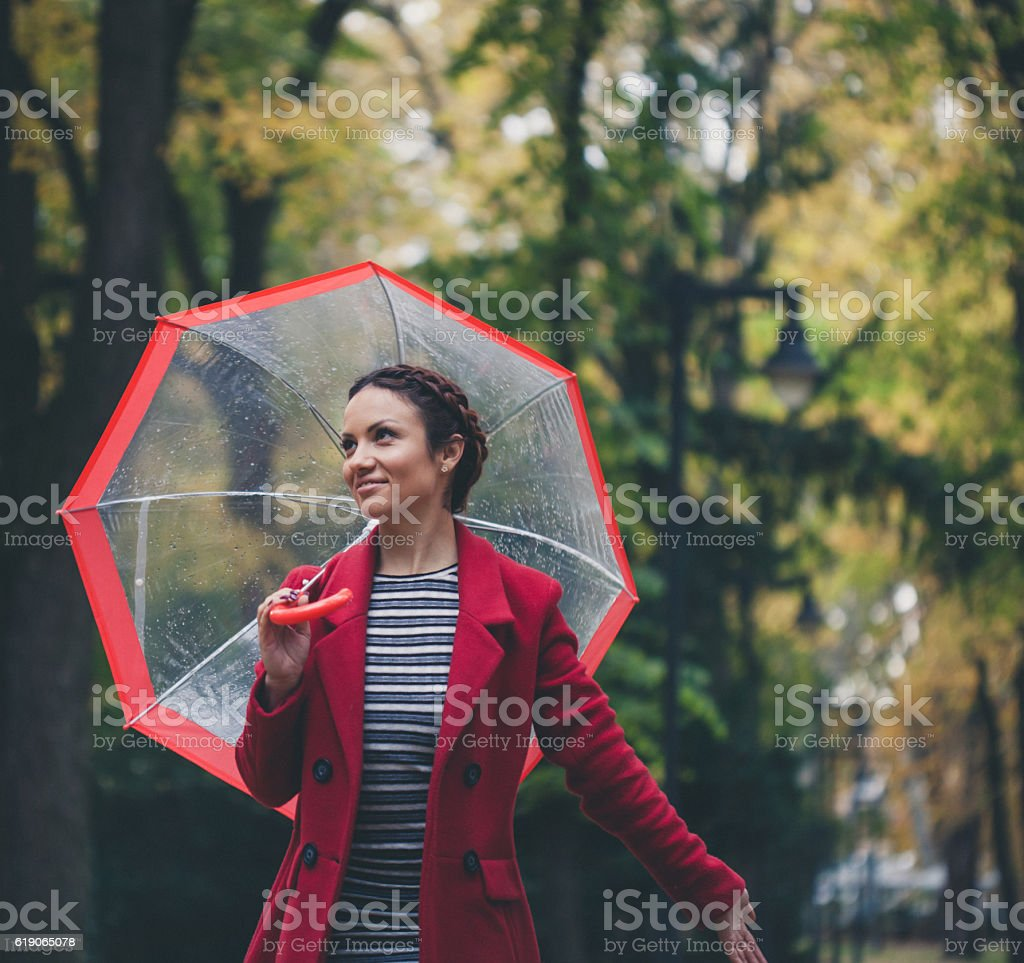 Beautiful young enjoying a rainy day