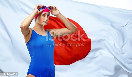 Beautiful Young Female Athlete posing in front of the Japanese flag