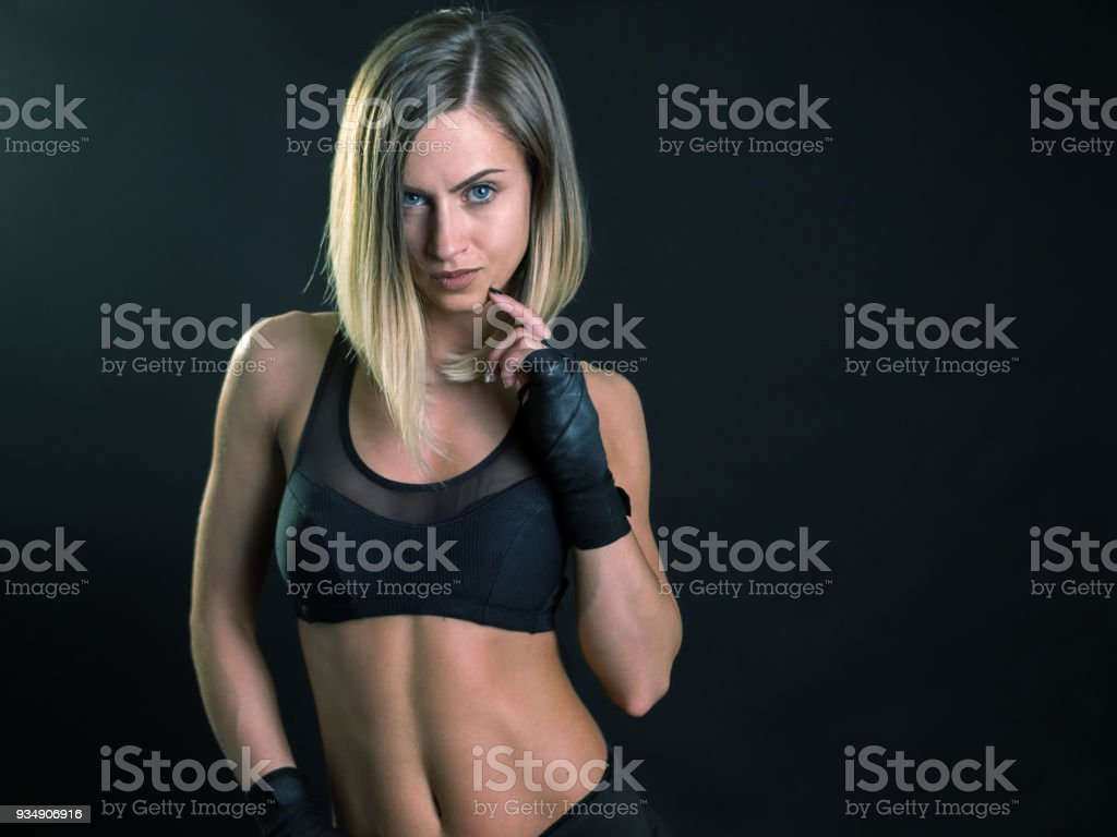 Beautiful young female fitness model posing looking at camera stock photo