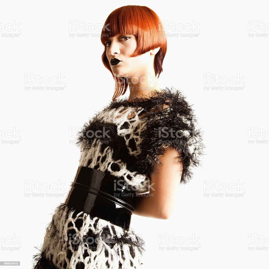 Beautiful Young Female Model in Avant-Garde Attire royalty-free stock photo
