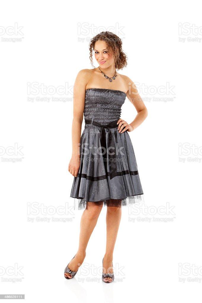 Beautiful young female model posing in stylish dress stock photo