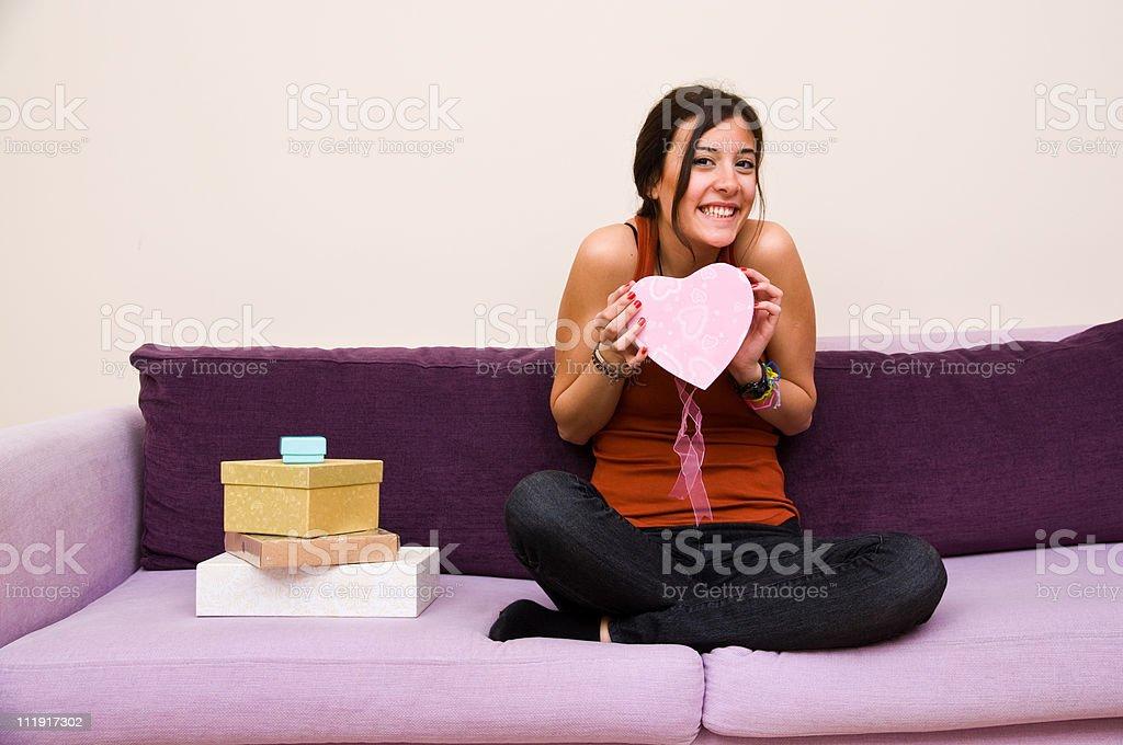 Beautiful young female opening gift box royalty-free stock photo