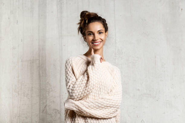 Beautiful young female posing in warm sweater stock photo