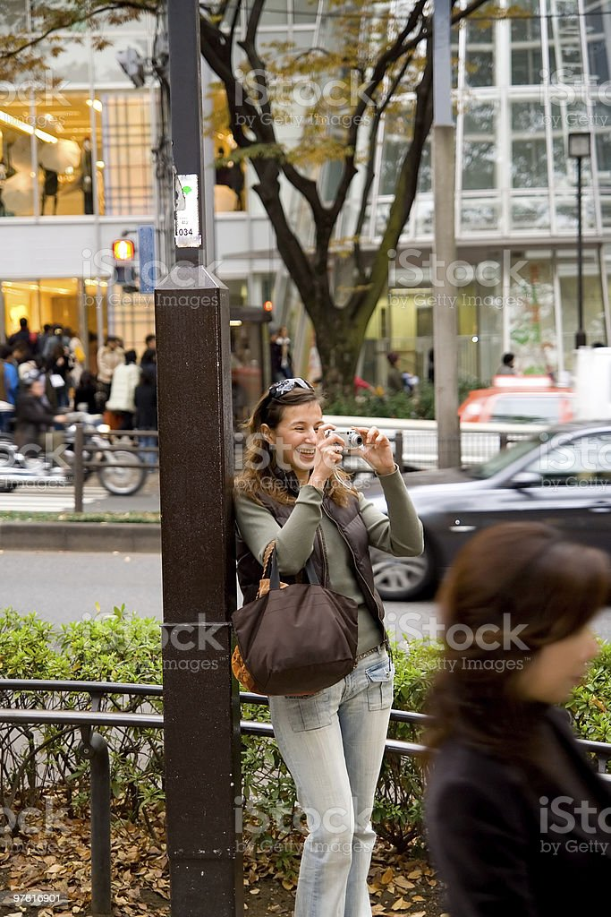 Beautiful young female taking pictures royaltyfri bildbanksbilder