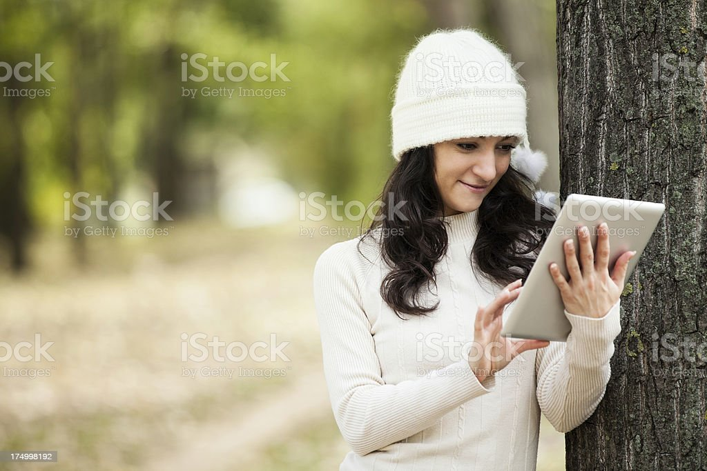 Beautiful young female with tablet royalty-free stock photo