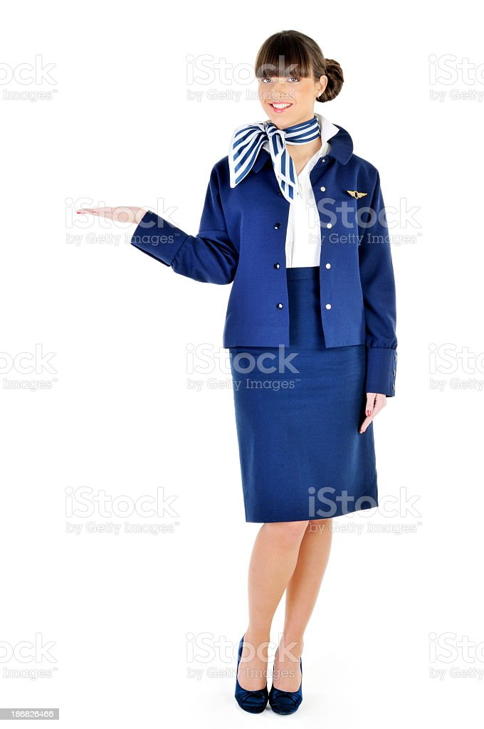 Beautiful young flight attendant welcome stock photo