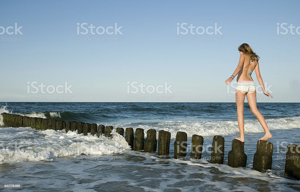 Beautiful young girl at the beach royalty-free stock photo