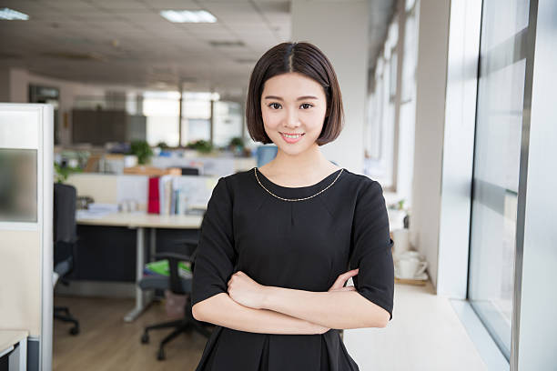 beautiful young girl chairman young beautiful girl, sitting in the office began her work civil servant stock pictures, royalty-free photos & images