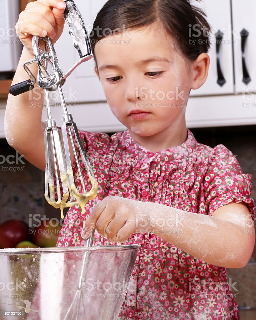 Beautiful young girl cooking royalty-free stock photo