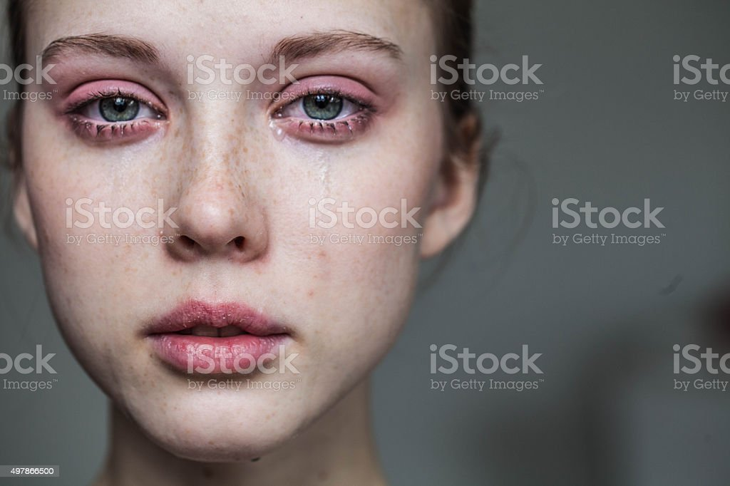 beautiful young girl crying stock photo