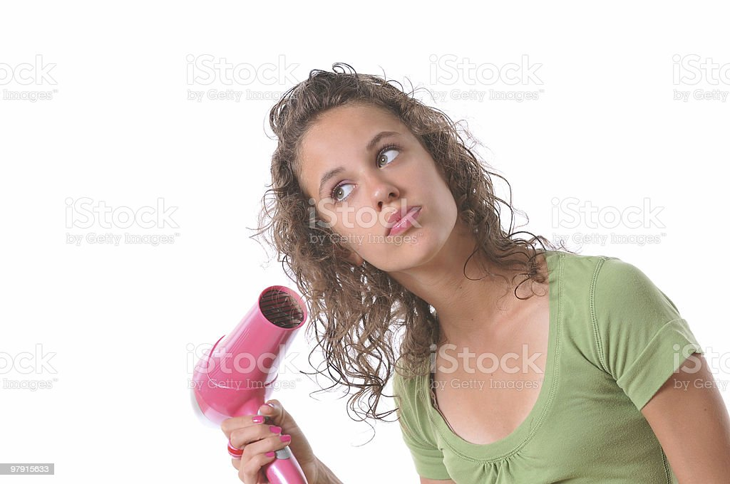Beautiful young girl drying her hair royalty-free stock photo