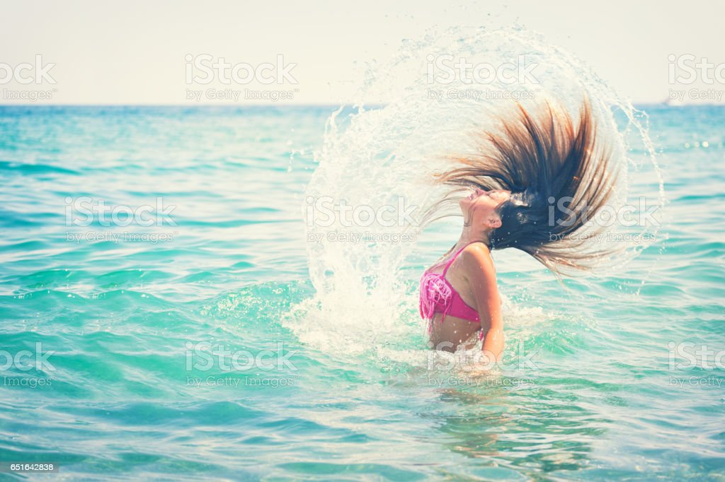 Beautiful Young Girl Enjoying on The Beach stock photo