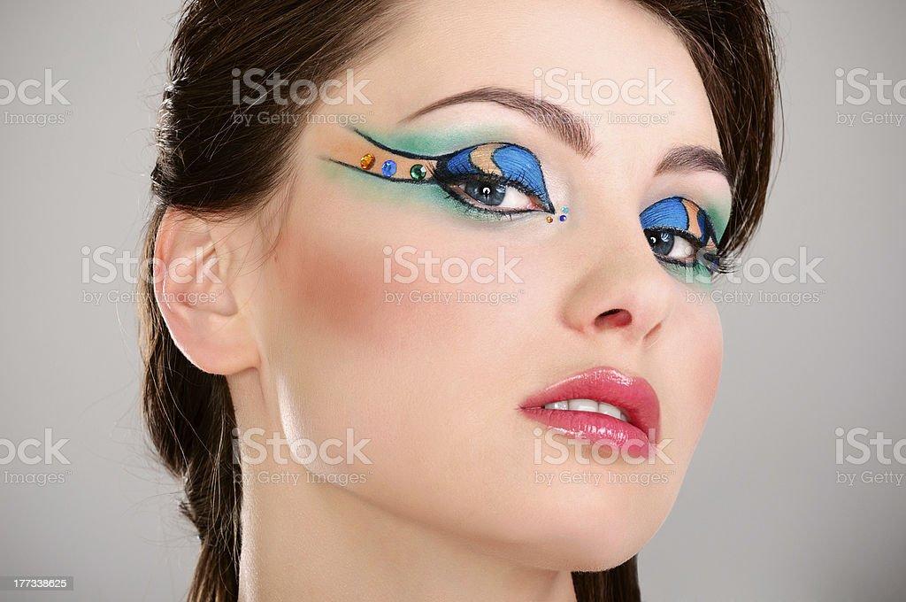 Beautiful young girl face with makeup stock photo