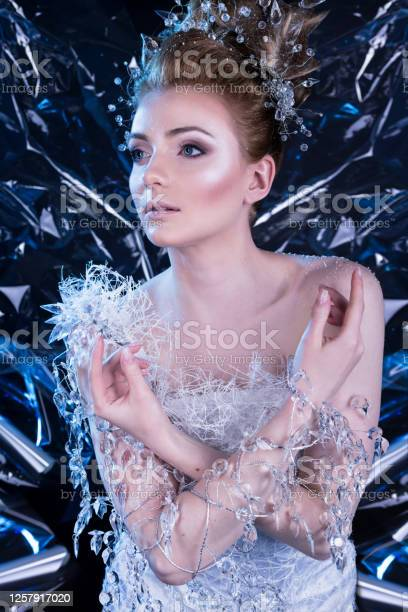Beautiful young girl in a snow queen costume model in winter ice picture id1257917020?b=1&k=6&m=1257917020&s=612x612&h=0ejvgdk1vma82y yk6azhezjdateuiq6pg6y49awtlc=