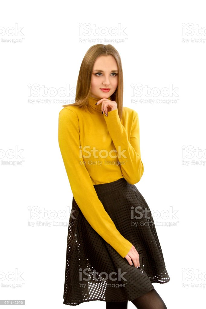 beautiful young girl in a yellow sweater and a black skirt stock photo