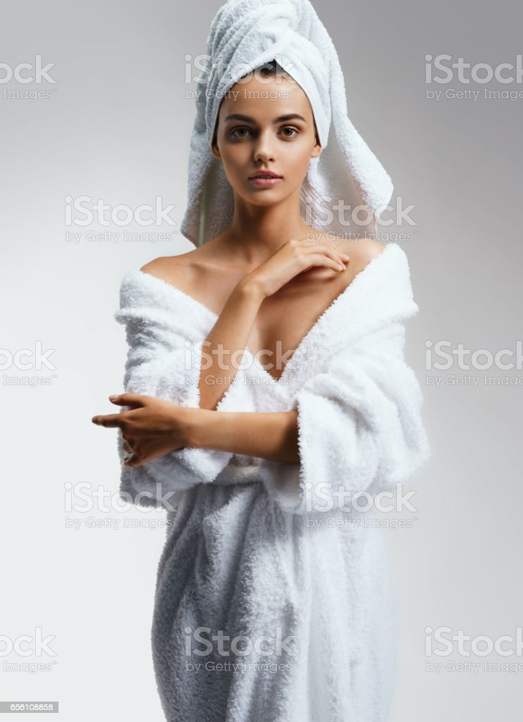 Beautiful Young girl in white bathrobe after spa. stock photo