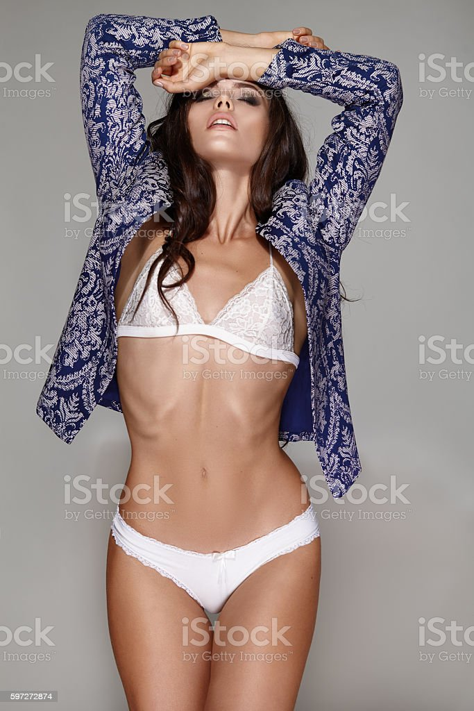 Beautiful young girl in white lingerie and jacket Lizenzfreies stock-foto