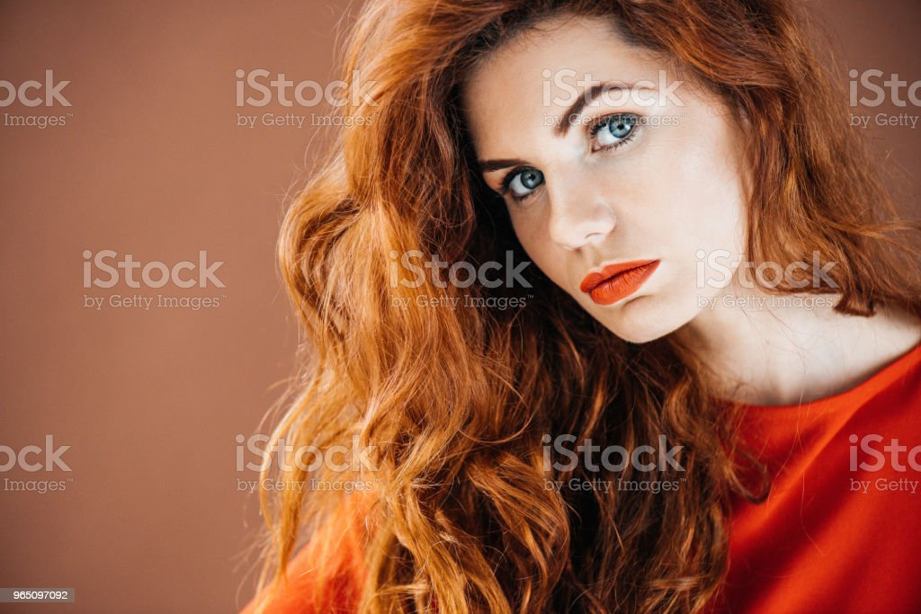 Beautiful young girl isolated on brown background zbiór zdjęć royalty-free