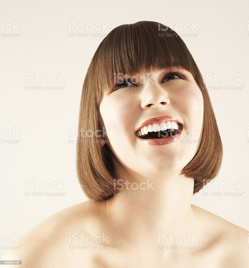 Beautiful young girl laughing and looking up royalty-free stock photo