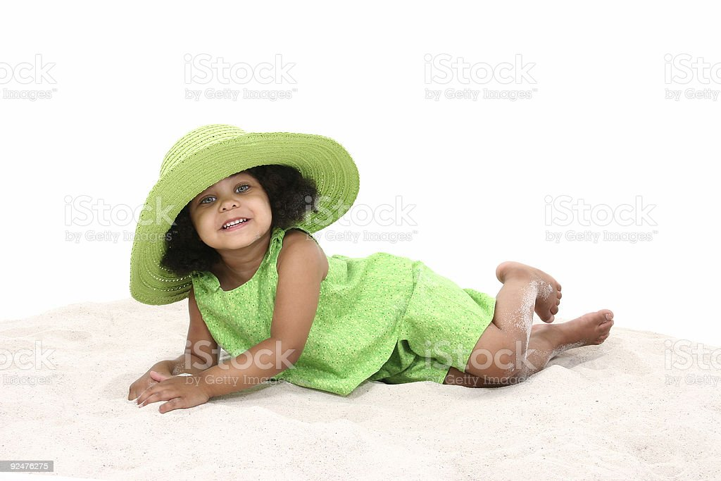 Beautiful Young Girl Laying In the Sand royalty-free stock photo