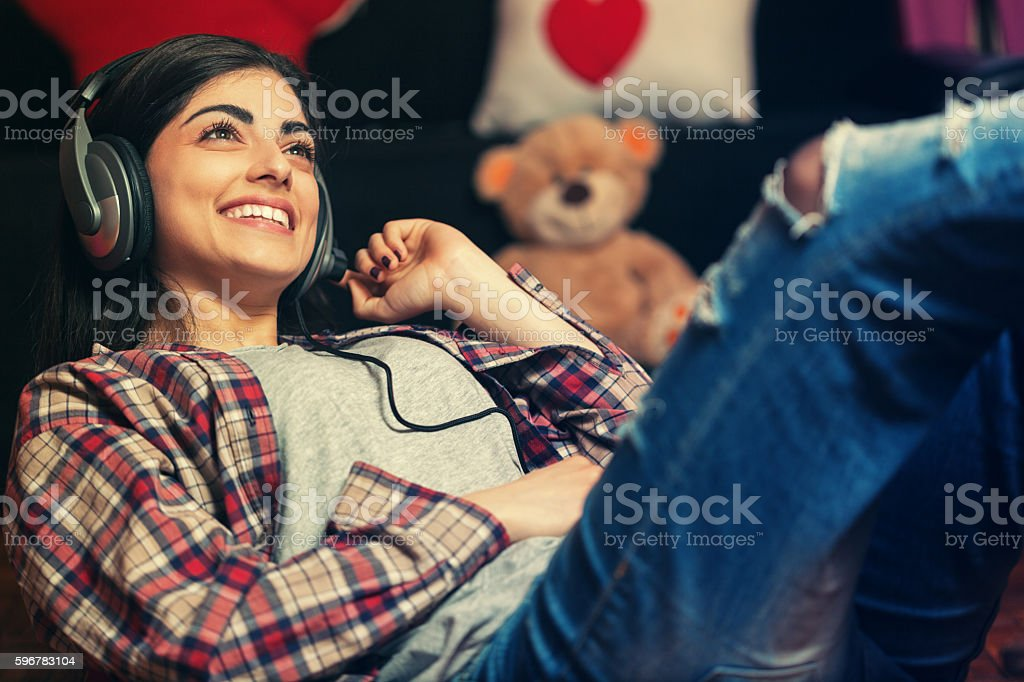 Beautiful Young Girl Listening Music stock photo
