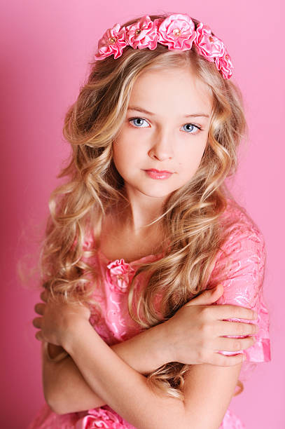 Beautiful young girl on pink background stock photo