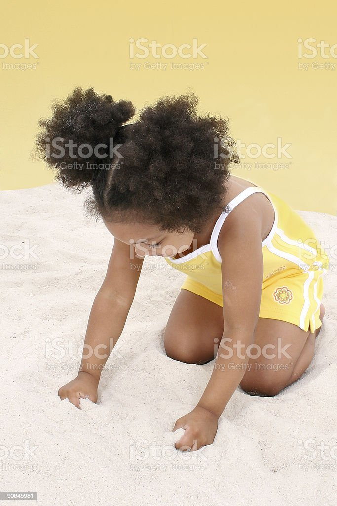 Beautiful Young Girl Playing In the Sand royalty-free stock photo