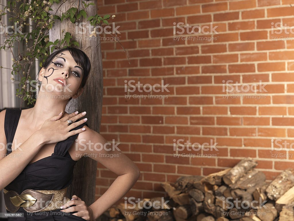 Beautiful young girl posing under a pergola royalty-free stock photo