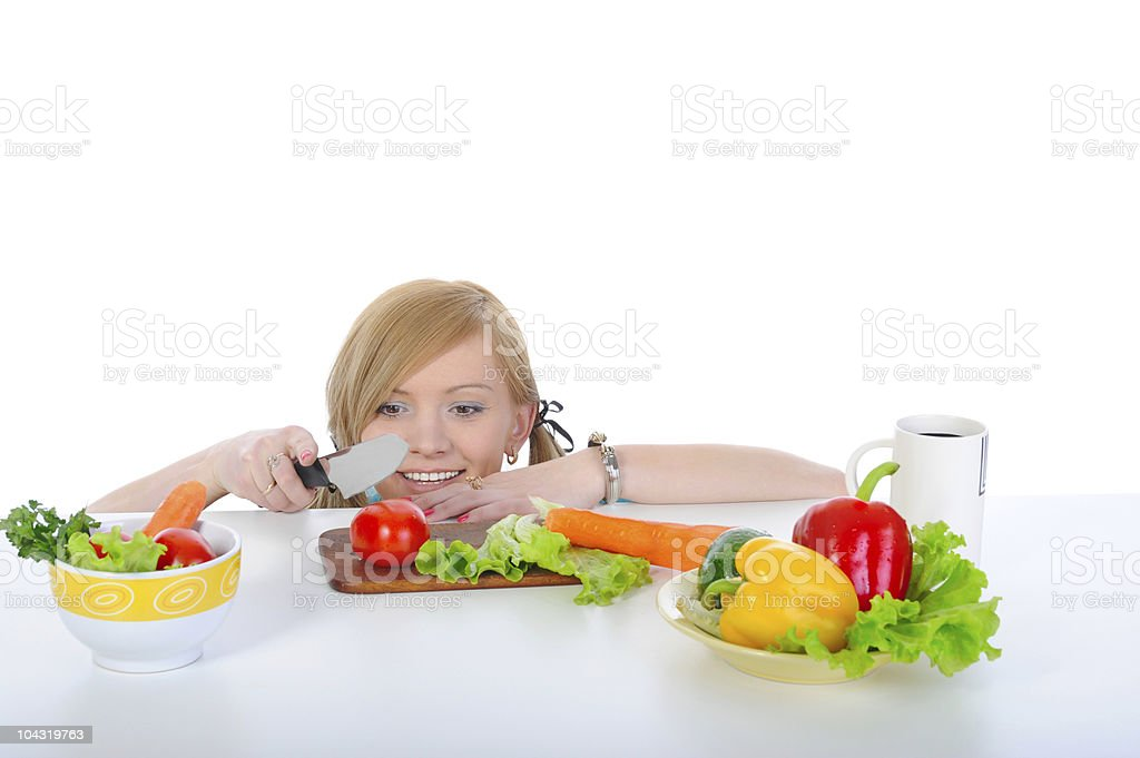 beautiful young girl preparing breakfast at the kitchen table. royalty-free stock photo