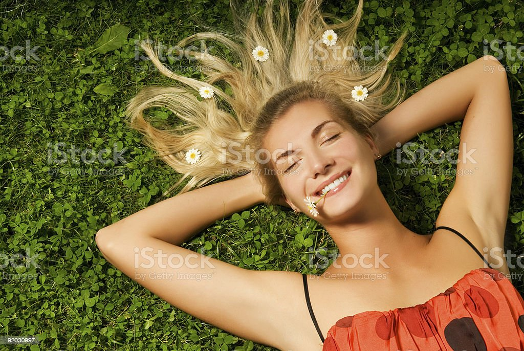 Beautiful young girl relaxing on a meadow royalty-free stock photo