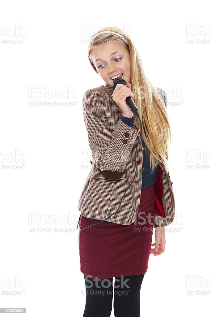 Beautiful young girl singing into a microphone on white royalty-free stock photo