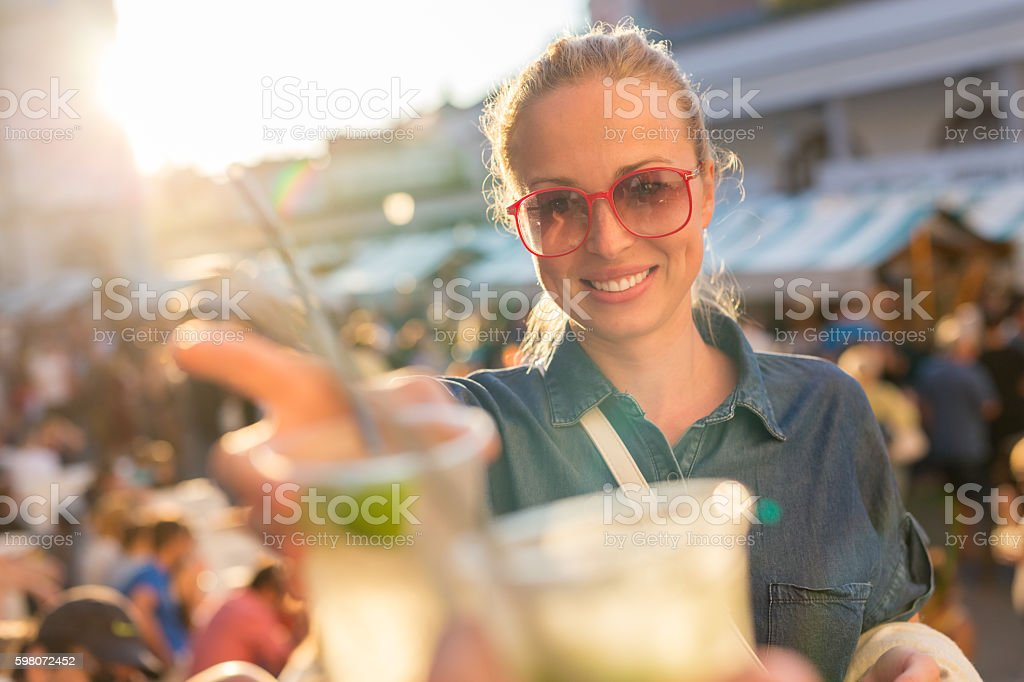 Beautiful young girl toasting on outdoor urban event. Lizenzfreies stock-foto