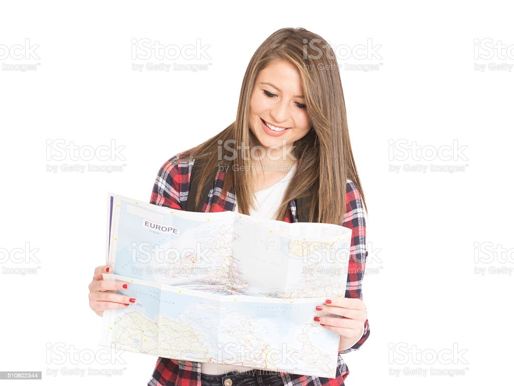 beautiful young girl tourist looks at a map stock photo