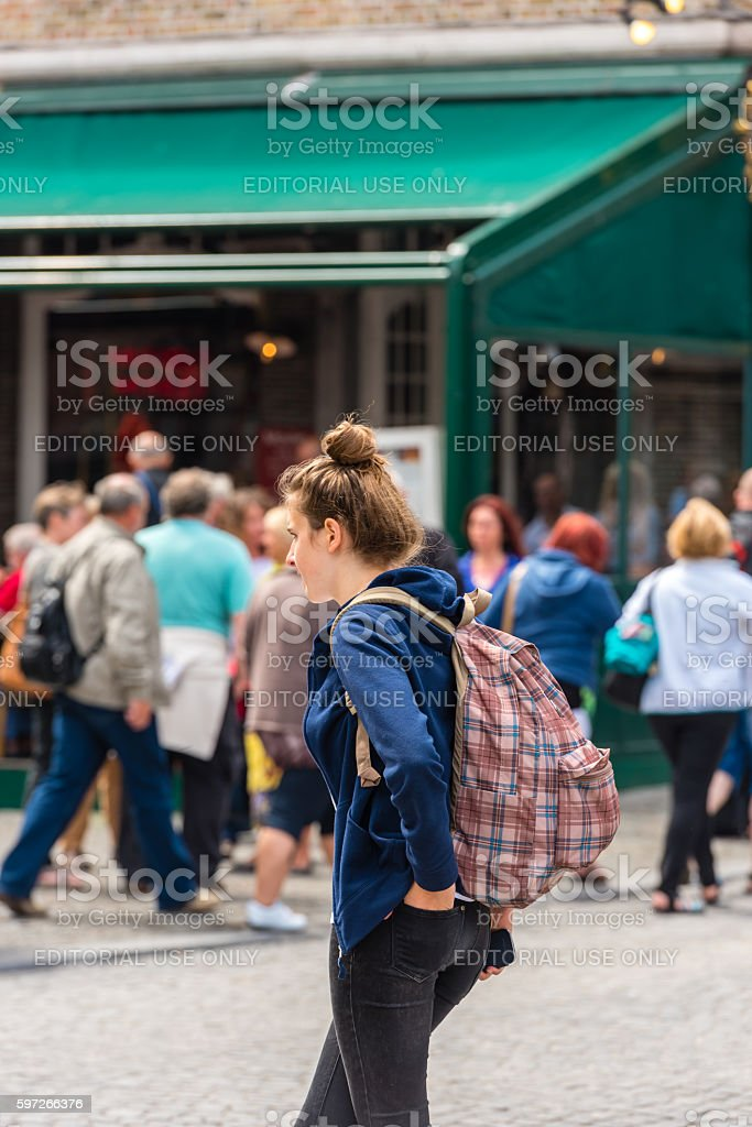Beautiful young girl uses smartphone royalty-free stock photo
