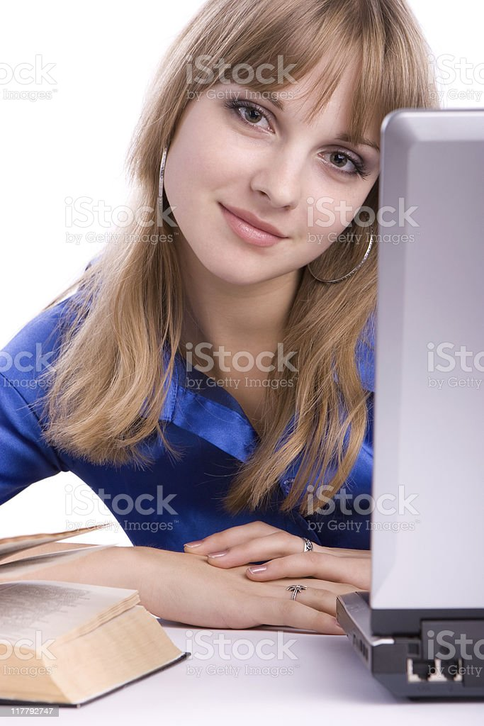 Beautiful young girl using laptop and book royalty-free stock photo