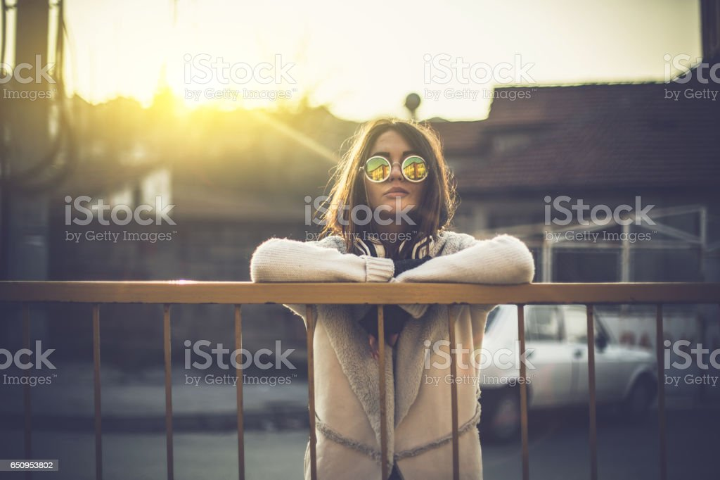Beautiful young girl with a headphones stock photo