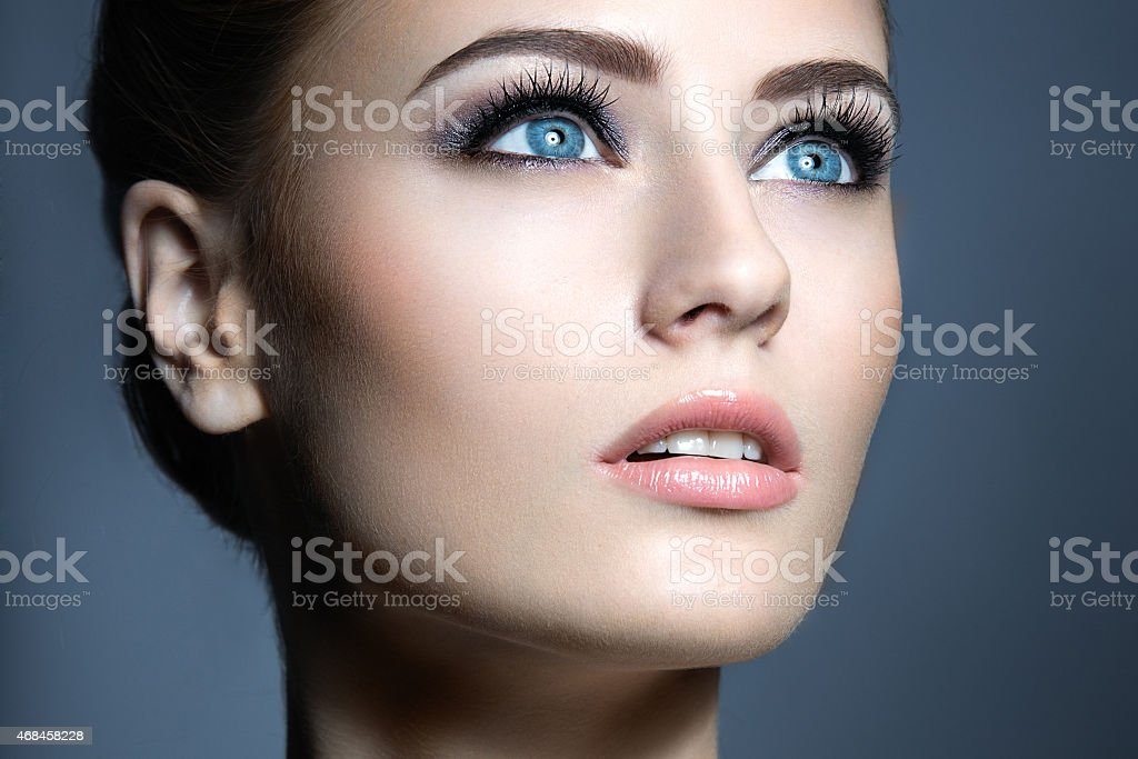 Beautiful young girl with a light natural make-up. stock photo