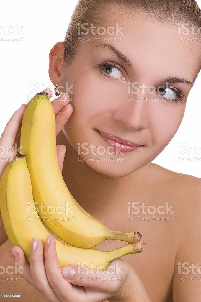 Beautiful young girl with banana royalty-free stock photo