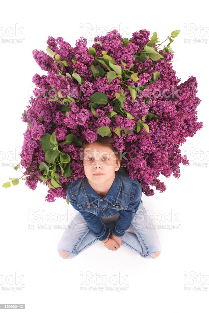 Beautiful young girl with Blooming flowers on her head. stock photo