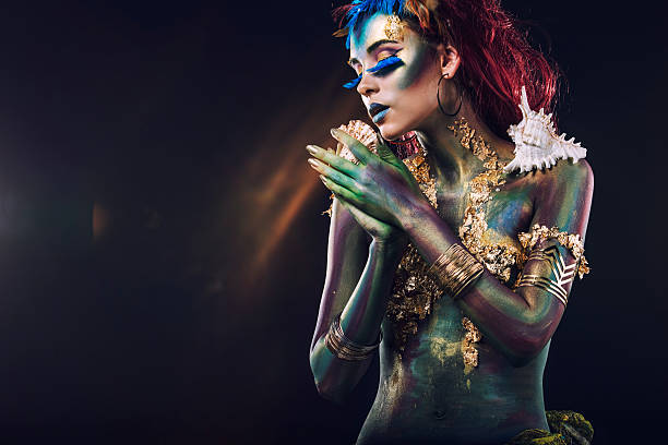 Beautiful young girl with body art in an  fantasy style Beautiful young girl with body art in an unusual fantasy style body paint stock pictures, royalty-free photos & images