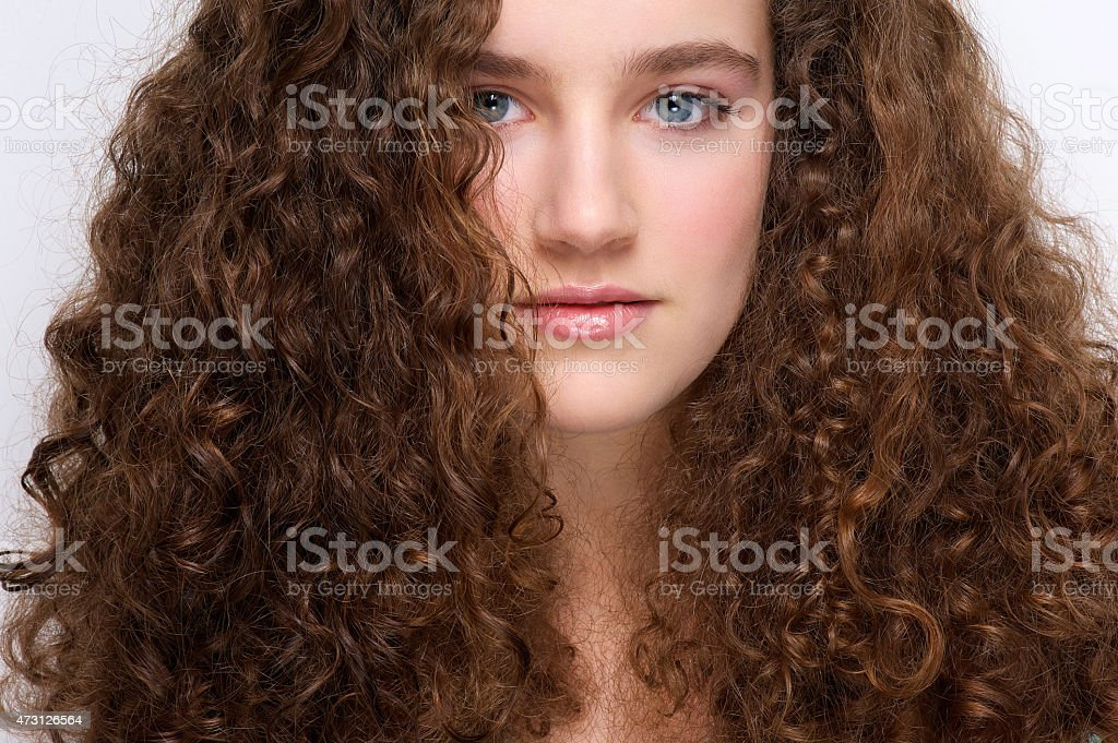 Beautiful young girl with curly hair stock photo