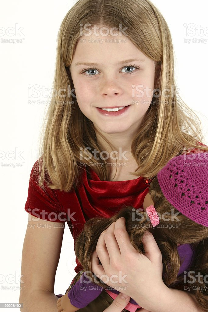Beautiful Young Girl with Doll stock photo