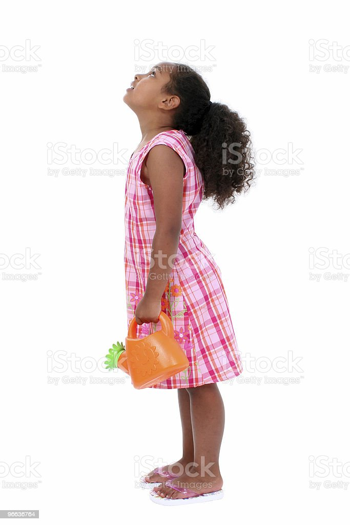 Beautiful Young Girl With Flower Watering Can Looking Up stock photo