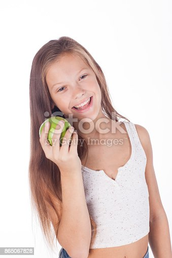 104545719istockphoto Beautiful young girl with green apple. 865067828